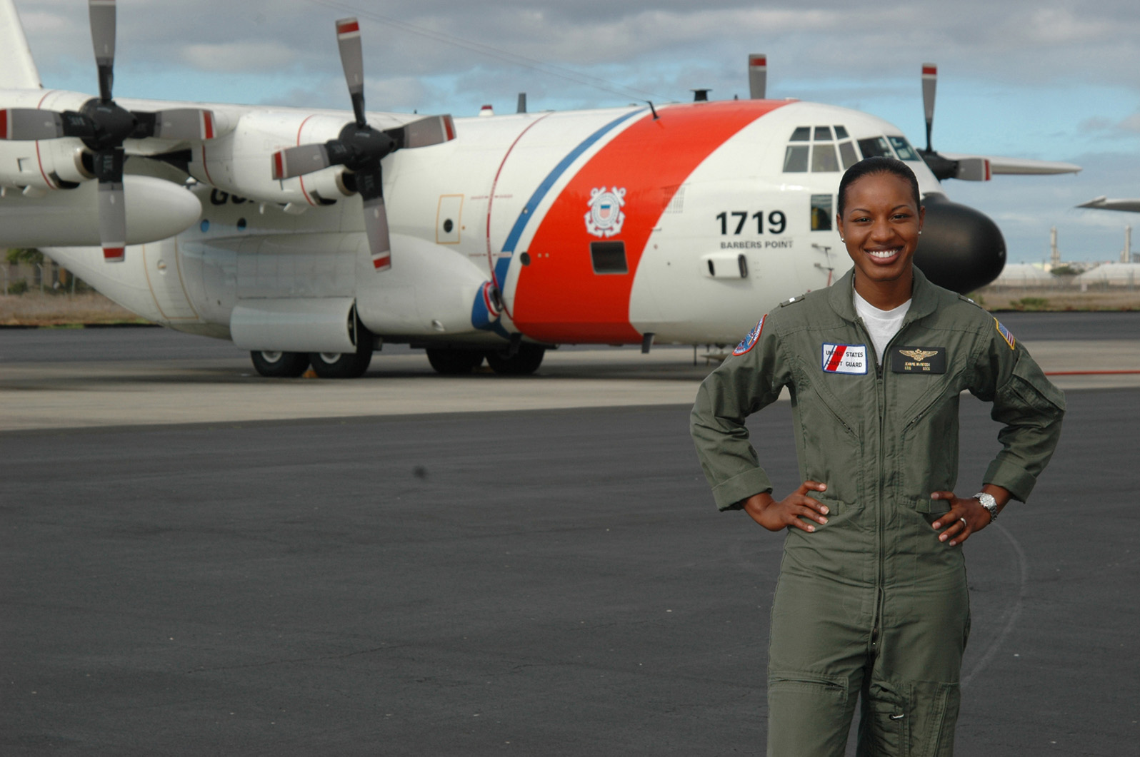 The first African American female pilot in the Coast Guard, LTJG Jeanine McIntosh poses in front of her HC-130.