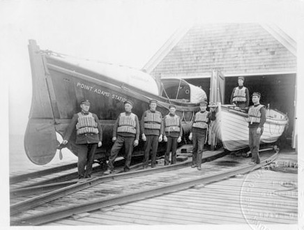 Crew standing outside of Point Adams Life-Saving Station