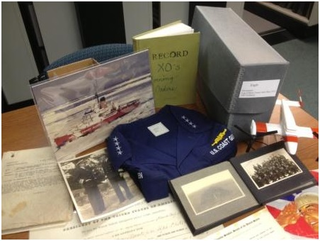 A photo of some examples of Coast Guard artifacts and archival items